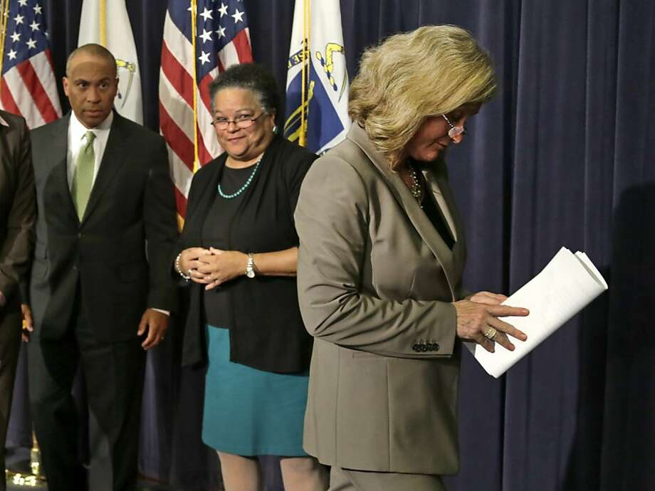 Gov. Deval Patrick; HHS Secretary Judy Ann Bigby; and Dr. Madeleine Biondolillo, director of healthcare safety, address the media. Photo: Charles Krupa, Associated Press