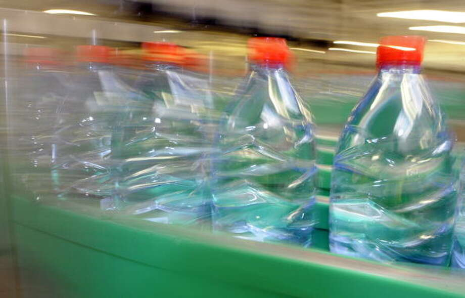 Bottles are seen on a production line on July 19, 2010 in Vittel, at the mineral water bottling plant of Nestle Waters Supply est company. AFP PHOTO JEAN-CHRISTOPHE VERHAEGEN Photo: JEAN-CHRISTOPHE VERHAEGEN, . / 2010 AFP