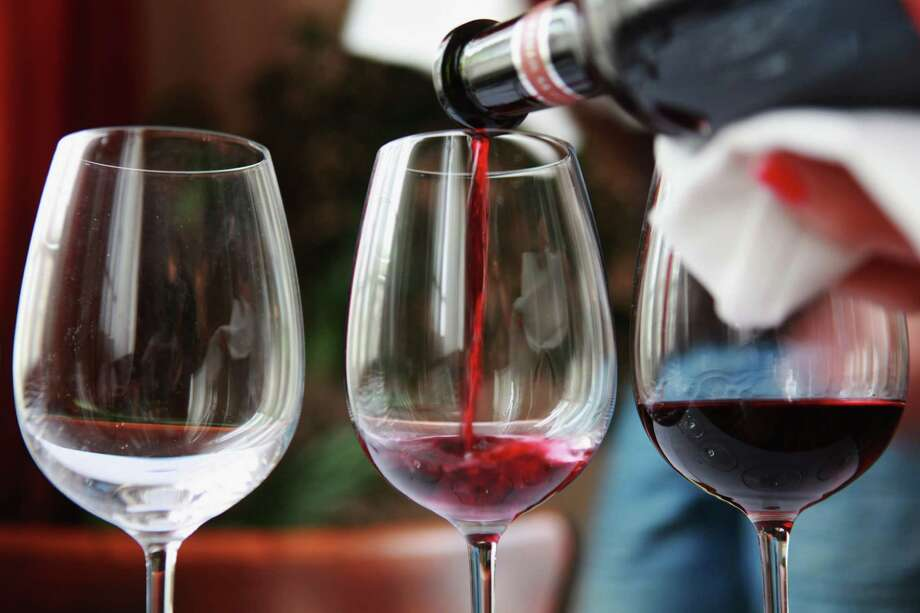 TRUE OR FALSE:Drinking a daily glass or two of any kind of alcohol - doesn't have to be red wine - reduces the risk of a heart attack. Photo: David Silverman, . / 2010 Getty Images