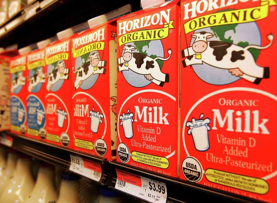 TRUE OR FALSE: So organic food isn't more more nutritious. But that super-expensive organic milk is healthier than regular milk, because it doesn't have bovine growth hormone. Photo: Tim Boyle, . / 2006 Getty Images