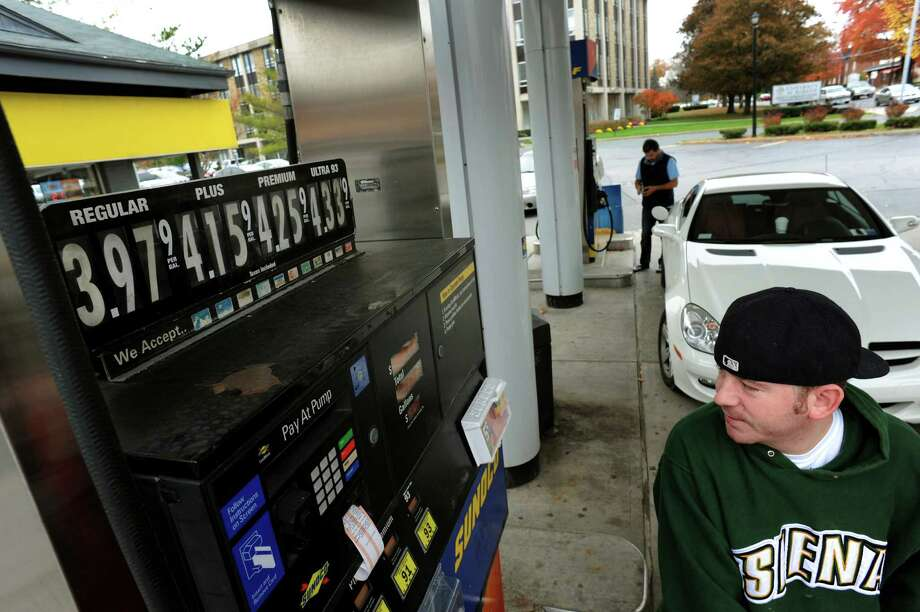 Joseph Arnold of Albany fills up his gas tank on Wednesday, Oct. 24, 2012, at Sunoco in Albany, N.Y. (Cindy Schultz / Times Union) Photo: Cindy Schultz / 00019805A