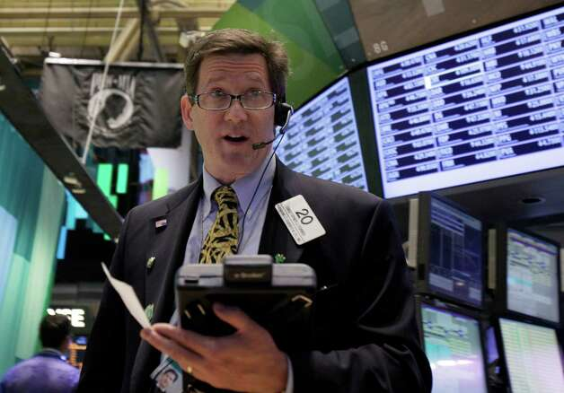 Trader Christopher Forbes works on the floor of the New York Stock Exchange Wednesday, Oct. 24, 2012. Stocks are opening higher on Wall Street, following a big drop the day before, after big companies including Boeing reported stronger profits. (AP Photo/Richard Drew) Photo: Richard Drew