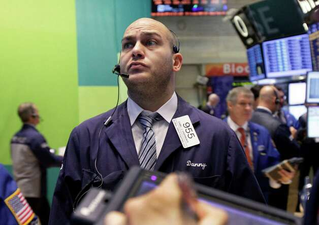 Trader Daniel Chiarmonte works on the floor of the New York Stock Exchange Wednesday, Oct. 24, 2012. Stocks are opening higher on Wall Street, following a big drop the day before, after big companies including Boeing reported stronger profits. (AP Photo/Richard Drew) Photo: Richard Drew