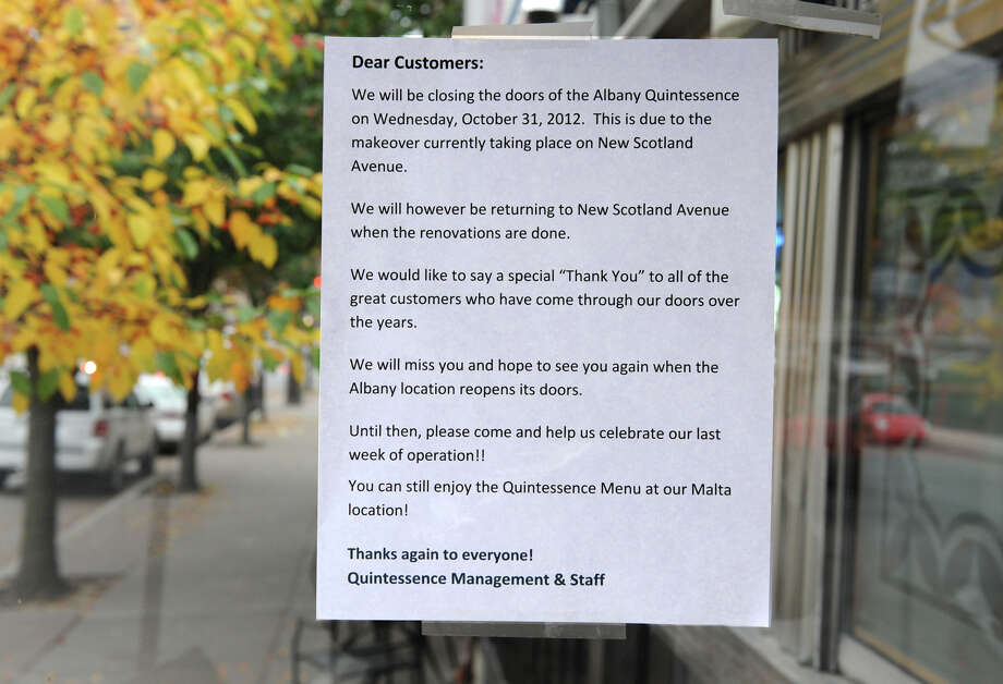 A sign is posted on the front door of Quintessence Wednesday, Oct. 24, 2012 notifying customers the restaurant will be closing Oct. 31 in Albany, N.Y. (Lori Van Buren / Times Union) Photo: Lori Van Buren