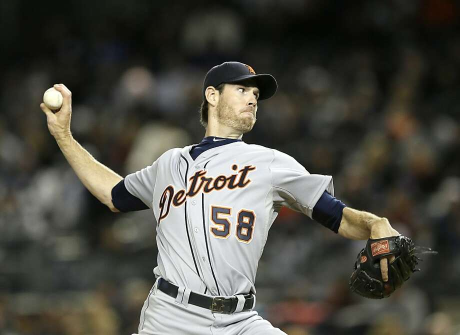 Detroit Tigers starting pitcher Doug Fister throws in the first inning during Game 1 of the American League championship series against the New York Yankees Saturday, Oct. 13, 2012, in New York. (AP Photo/Matt Slocum) Photo: Matt Slocum, Associated Press