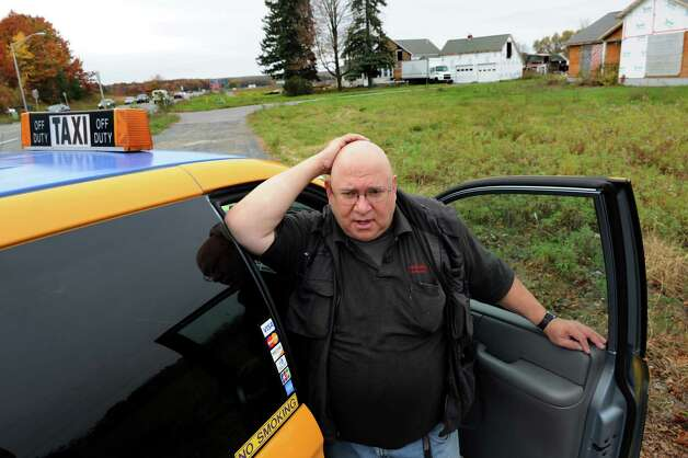 Taxi driver Steve Smith on Wednesday, Oct. 24, 2012, at the former Engel's Farm in Colonie, N.Y. Smith took pictures of an old greenhouse on the property which suggested the outline of Jesus or Mary at night when car headlights reflected off it. The greenhouse was recently torn down. (Cindy Schultz / Times Union) Photo: Cindy Schultz /  00019797A