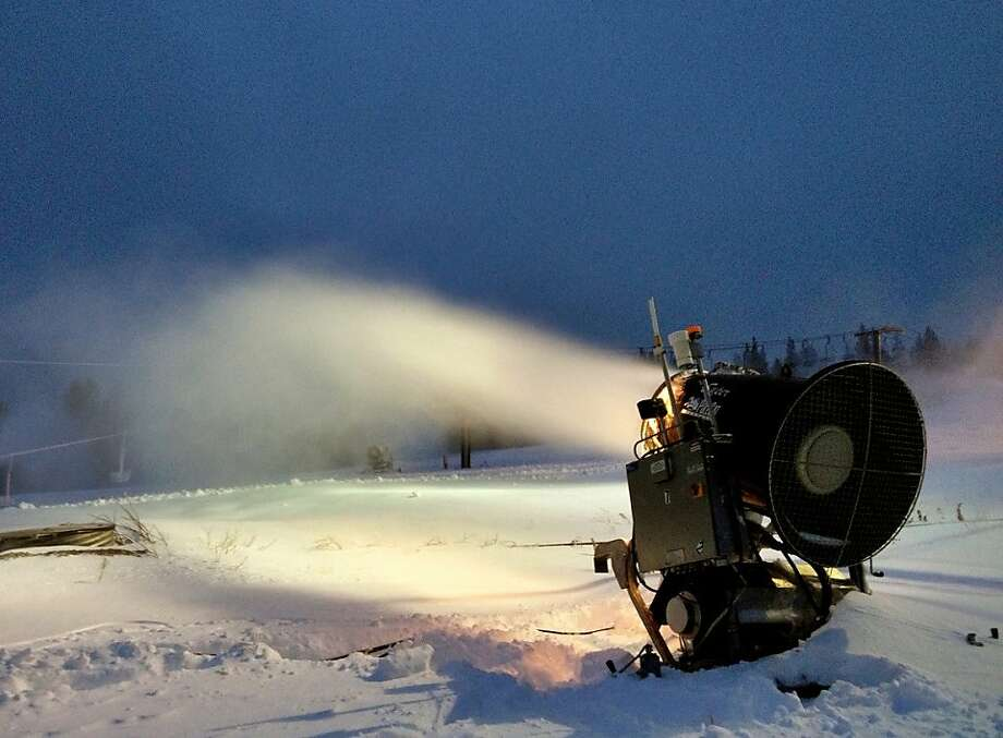 A snow-making machine at Boreal Mountain Resort spews man-made flurries to complement two storms this week that have enabled an early opening Friday. Photo: Anders Isaacson