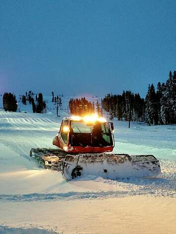 A groomer prepares a ski run Wednesday evening after storms dropped 3 feet of snow at Boreal near Donner Pass this week. Photo: Anders Isaacson