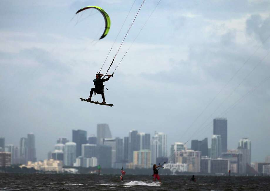 Santiago Porteiro takes advantage of the winds from the outerbands of Hurricane Sandy to kite surf on October 24, 2012 in Miami, Florida. After passing over Jamaica, Sandy is expected to hit eastern Cuba on Wednesday night and into the Bahamas Thursday and Friday, a tropcial storm warning was issued for east coast of Florida from Ocean Reef to Sebasian Inlet and a tropical storm watch was extended along the east coast to Flagler Beach. Photo: Joe Raedle, Getty Images / 2012 Getty Images