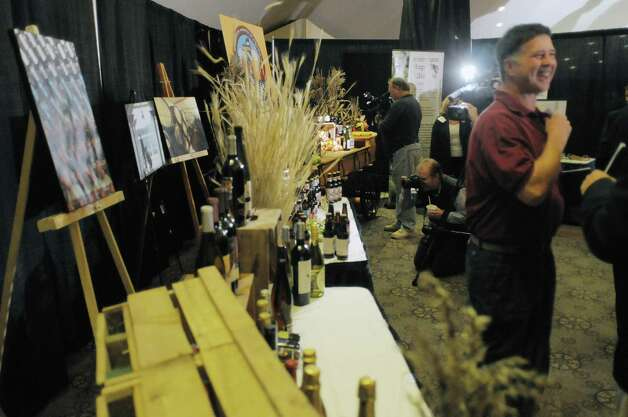 Members of the media film beer and wine displays at the  first Wine, Beer and Spirits Summit held at The Egg on Wednesday, Oct. 24, 2012 in Albany, NY.  The governor held the summit to discuss state policies that are or could be beneficial to the industry.     (Paul Buckowski / Times Union) Photo: Paul Buckowski