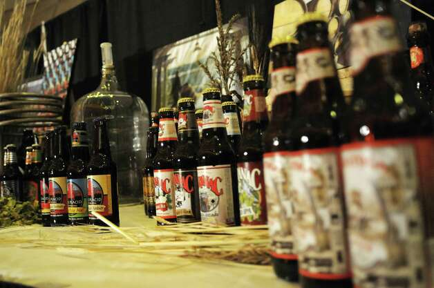 Different beers brewed in the state are seen on display at the  first Wine, Beer and Spirits Summit held at The Egg on Wednesday, Oct. 24, 2012 in Albany, NY.  The governor held the summit to discuss state policies that are or could be beneficial to the industry.     (Paul Buckowski / Times Union) Photo: Paul Buckowski