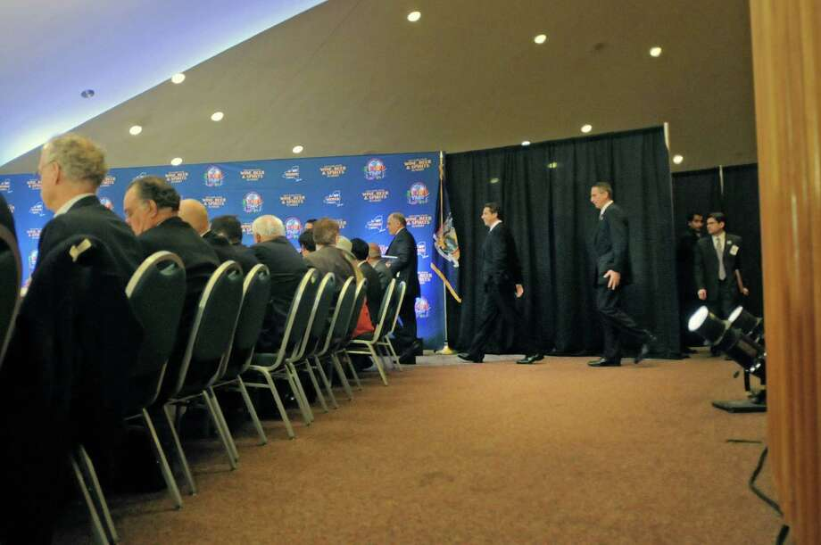 Governor Andrew Cuomo, center, and Lieutenant Governor Robert Duffy make their way into the Wine, Beer and Spirits Summit held at The Egg on Wednesday, Oct. 24, 2012 in Albany, NY.  The governor held the summit to discuss state policies that are or could be beneficial to the industry.     (Paul Buckowski / Times Union) Photo: Paul Buckowski