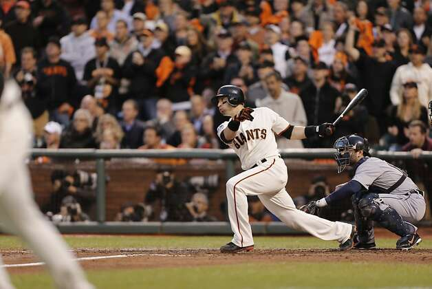 The Giants' Marco Scutaro singles in the third inning during Game 1 of the World Series at AT&T Park on Wednesday, Oct. 24, 2012 in San Francisco, Calif. Photo: Michael Macor, The Chronicle