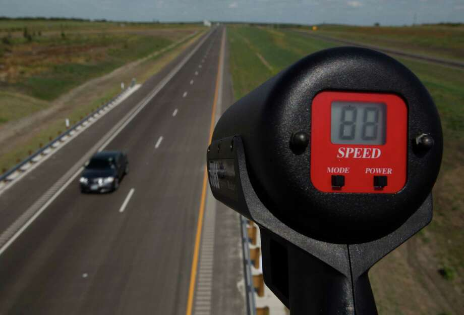 It may look fast on the radar gun, but this car was traveling just 3 mph over the speed limit Wednesday. Photo: William Luther / San Anotnio Express-News