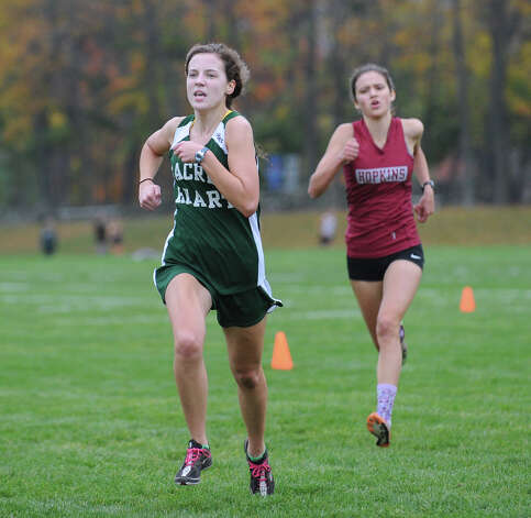 At left, Julie Randolph of Convent of the Sacred Heart was the top girls finisher during the high school cross country meet at Brunswick School in Greenwich, Wednesday, Oct. 24, 2012. Photo: Bob Luckey / Greenwich Time