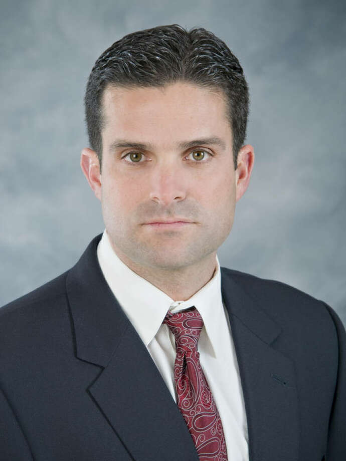 In this 2010 handout photo released by Mississippi State Athletics, defensive coordinator Manny Diaz is shown. A person with knowledge of the decision says Diaz has accepted an offer to hold the same job at Texas. Diaz replaces Will Muschamp, who left Texas after three seasons to become the head coach at Florida. The person who confirmed the Diaz hire spoke on condition of anonymity on Wednesday, Jan. 5, 2011, because the hire has not been formally announced. (AP Photo/Mississippi State Athletics) ** NO SALES, EDITORIAL USE ONLY ** / Mississippi State Athletics