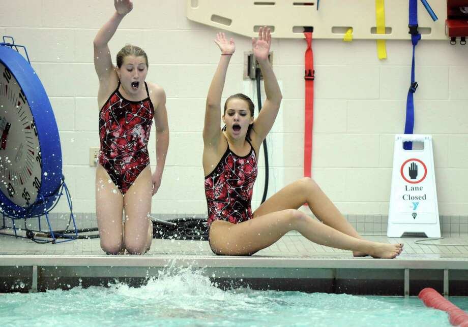 Scotia-Glenville High School girls swim team members Kylie George, left, and Sierra Carlstadt, right, cheer on teammate Emma Brown during their last home meet at Schenectady High School on Tuesday Oct. 23, 2012 in Schenectady, NY.   The team is self-funded due to budget cuts, with only three members.  (Philip Kamrass /  Times Union) Photo: Philip Kamrass / 10019777A
