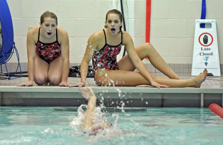 Scotia-Glenville High School girls swim team members Kylie George, left, and Sierra Carlstadt, right