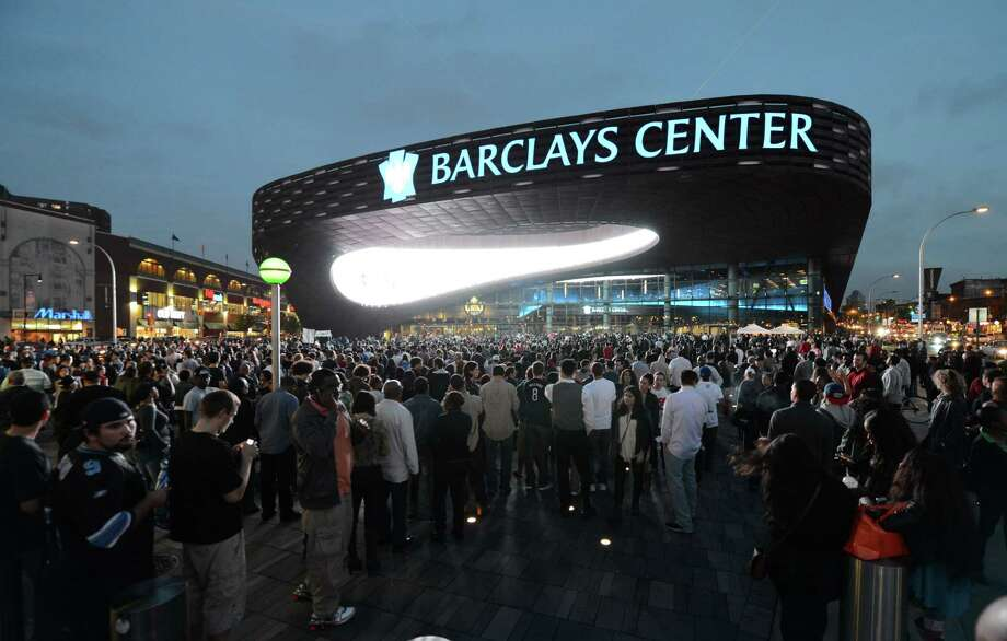 FILE - This Sept. 28, 2012 file photo shows people arriving for the first of eight Jay-Z shows at the Barclays Center in the Brooklyn borough of New York. A person familiar with the situation says the New York Islanders have struck a deal to move to Barclays Center as early as 2015. The person was not authorized to discuss the situation prior to an afternoon announcement, Wednesday, Oct. 24, 2012,  and spoke to The Associated Press on condition of anonymity.(AP Photo/Henny Ray Abrams, File) Photo: Henny Ray Abrams