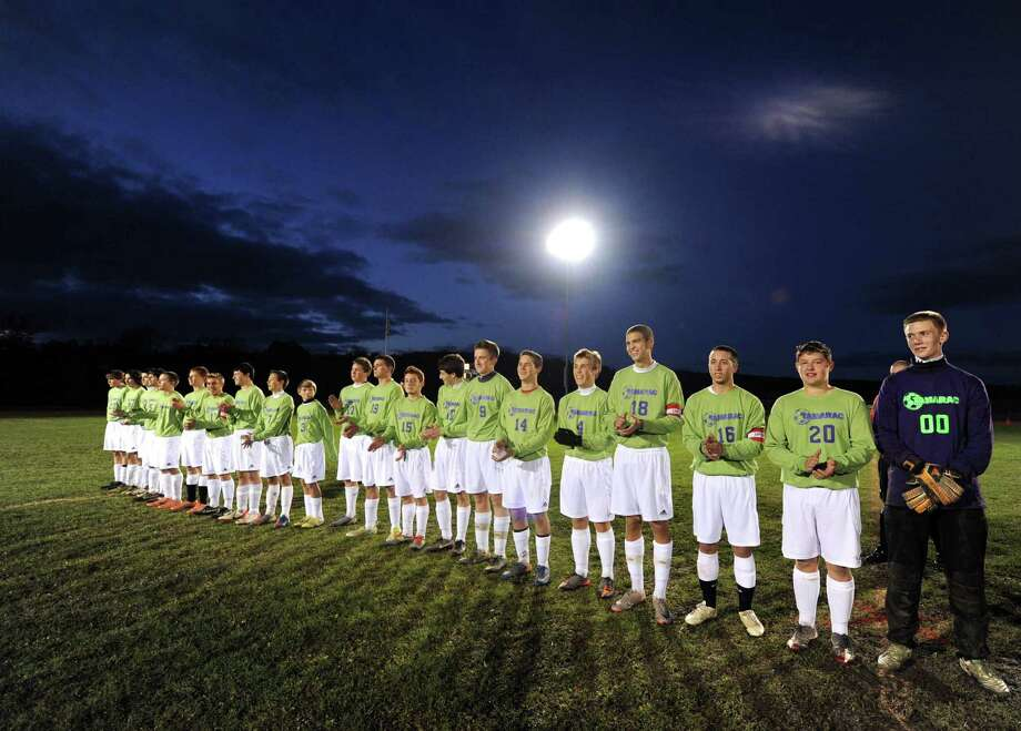 The Tamarac boys' soccer team wearing lime green shirts on their Senior Night to raise awareness for Lymphoma as they took on visiting Schuylerville in Troy, NY Tuesday Oct. 16, 2012. (Michael P. Farrell/Times Union) Photo: Michael P. Farrell