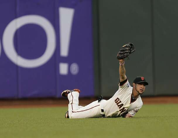Giants' left fielder Gregor Blanco shows that he caught a Miguel Cabrera line drive in the third inning of Game 1 of the World Series at AT&T Park on Wednesday, Oct. 24, 2012 in San Francisco, Calif. Photo: Michael Macor, The Chronicle