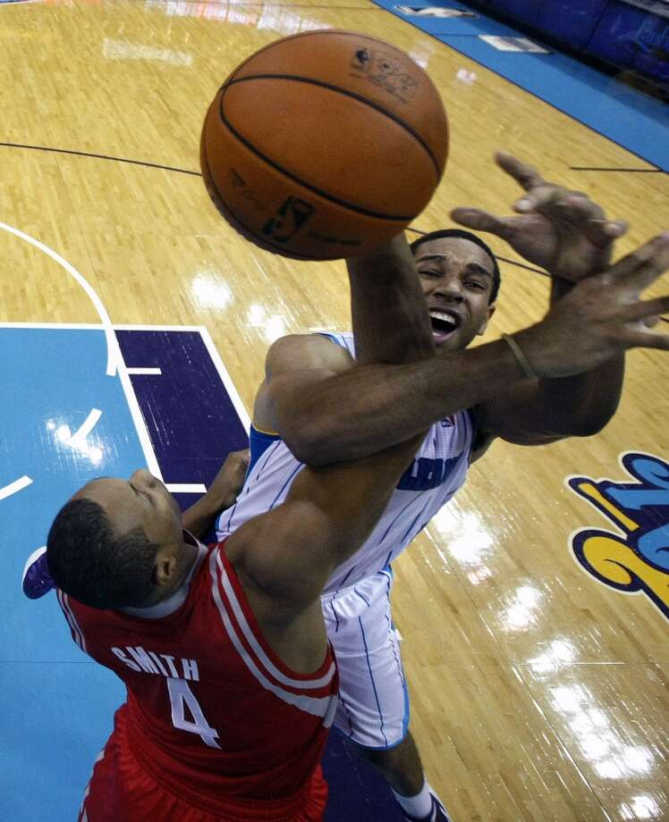 New Orleans Hornets shooting guard Xavier Henry, top, battles for a rebound with Houston Rockets power forward Greg Smith (4) in the second half of a preseason NBA basketball game in New Orleans, Wednesday, Oct. 24, 2012. The Rockets won 97-90. (AP Photo/Gerald Herbert) (Associated Press)