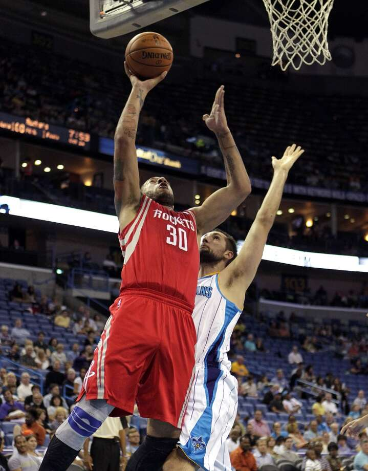 Houston Rockets power forward Royce White (30) drives to the basket against New Orleans Hornets power forward Ryan Anderson in the first half of a preseason NBA basketball game in New Orleans, Wednesday, Oct. 24, 2012. (AP Photo/Gerald Herbert) (Associated Press)