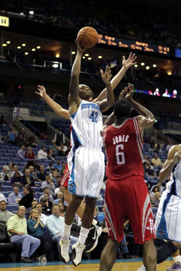 New Orleans Hornets small forward Lance Thomas (42) shoots over Houston Rockets power forward Terrence Jones (6) in the second half of a preseason NBA basketball game in New Orleans, Wednesday, Oct. 24, 2012. The Rockets won 97-90. (AP Photo/Gerald Herbert) (Associated Press)