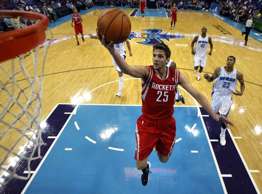 Houston Rockets small forward Chandler Parsons (25) drives to the basket in front of New Orleans Hornets power forward Anthony Davis (23) in the first half of a preseason NBA basketball game in New Orleans, Wednesday, Oct. 24, 2012. (AP Photo/Gerald Herbert) (Associated Press)