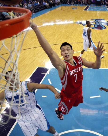 Houston Rockets point guard Jeremy Lin (7) drives to the basket between New Orleans Hornets point guard Greivis Vasquez (21) in the first half of an NBA basketball game in New Orleans, Wednesday, Oct. 24, 2012. (AP Photo/Gerald Herbert) (Associated Press)