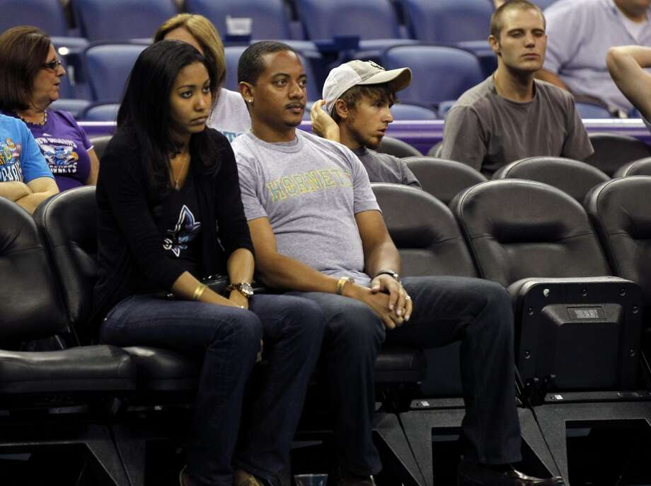 New Orleans Saints defensive end Will Smith watches in the second half of a preseason NBA basketball game between the New Orleans Hornets and the Houston Rockets in New Orleans, Wednesday, Oct. 24, 2012. The Rockets won 97-90. (AP Photo/Gerald Herbert) (Associated Press)