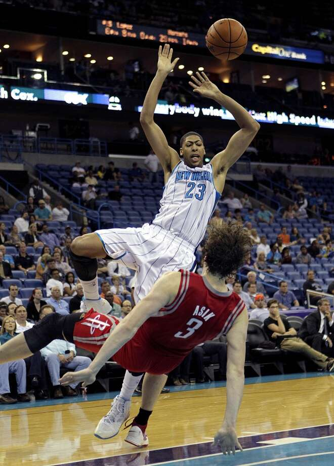 New Orleans Hornets power forward Anthony Davis (23) drives against Houston Rockets center Omer Asik (3) in the second half of a preseason NBA basketball game in New Orleans, Wednesday, Oct. 24, 2012. The Rockets won 97-90. (AP Photo/Gerald Herbert) (Associated Press)
