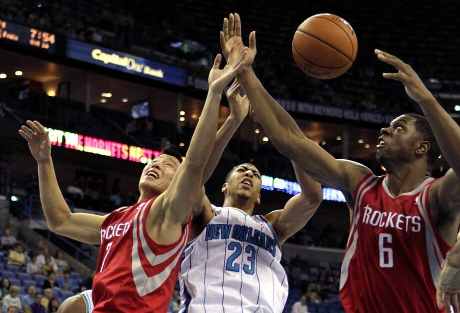 New Orleans Hornets power forward Anthony Davis (23) battles for a rebound between Houston Rockets point guard Jeremy Lin (7) and power forward Terrence Jones (6) in the first half of a preseason NBA basketball game in New Orleans, Wednesday, Oct. 24, 2012. (AP Photo/Gerald Herbert) (Associated Press)