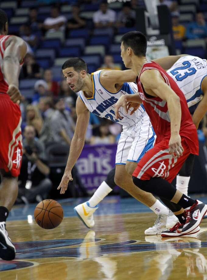 New Orleans Hornets point guard Greivis Vasquez (21) dribbles in the second half of a preseason NBA basketball game in New Orleans, Wednesday, Oct. 24, 2012. The Rockets won 97-90. (AP Photo/Gerald Herbert) (Associated Press)