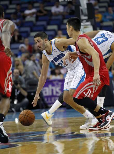 New Orleans Hornets point guard Greivis Vasquez (21) dribbles in the second half of a preseason NBA