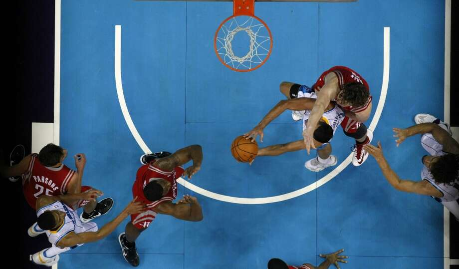 New Orleans Hornets point guard Greivis Vasquez, third from right, drives to the basket underneath Houston Rockets center Omer Asik in the first half of a preseason NBA basketball game in New Orleans, Wednesday, Oct. 24, 2012. (AP Photo/Gerald Herbert) (Associated Press)