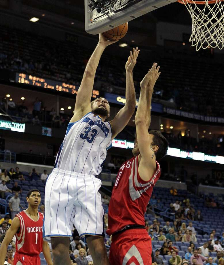 New Orleans Hornets power forward Ryan Anderson (33) drives to the basket against Houston Rockets shooting guard Carlos Delfino (10) in the second half of a preseason NBA basketball game in New Orleans, Wednesday, Oct. 24, 2012. The Rockets won 97-90. (AP Photo/Gerald Herbert) (Associated Press)