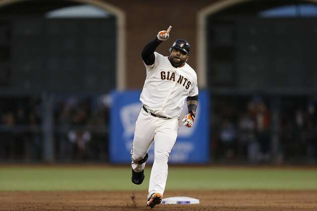 Giants' 3rd baseman Pablo Sandoval gestures while rounding the bases after hitting his second homerun of the game in the 3rd inning during game 1 of the World Series at AT&T Park on Wednesday, Oct. 24, 2012 in San Francisco, Calif. Photo: Michael Macor, The Chronicle