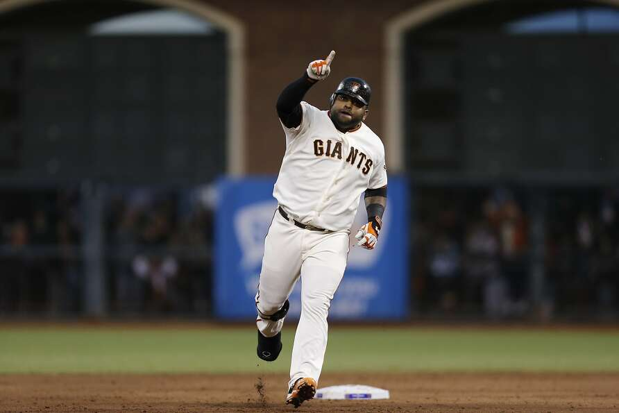 Giants' 3rd baseman Pablo Sandoval gestures while rounding the bases after hitting his second hom
