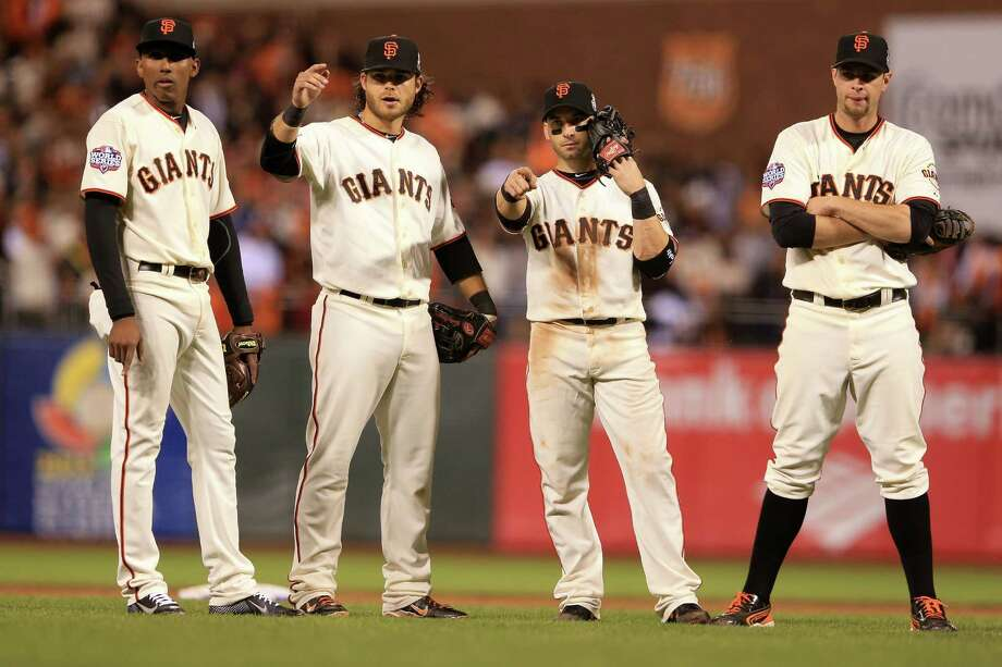 SAN FRANCISCO, CA - OCTOBER 24:  Brandon Crawford #35 of the San Francisco Giants celebrates with his teammates after defeating the Detroit Tigers in Game One of the Major League Baseball World Series at AT&T Park on October 24, 2012 in San Francisco, California. The Giants defeated the Tigers 8-3. Photo: Doug Pensinger, Getty Images / Getty Images North America