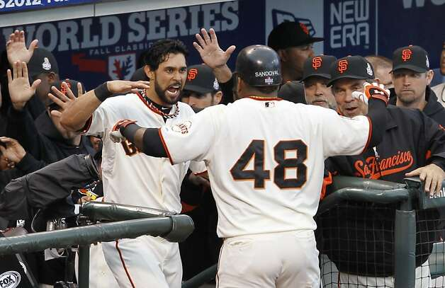 Giants' 3rd baseman Pablo Sandoval is greeted at the dugout after hitting his 1st inning home run during the World Series game 1 at AT&T Park in San Francisco, Calif., on Wednesday, Oct. 24, 2012. Photo: Brant Ward, The Chronicle