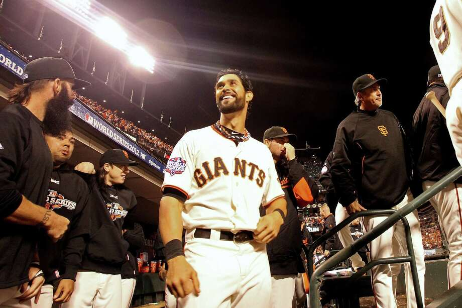 SAN FRANCISCO, CA - OCTOBER 24:  Angel Pagan #16 of the San Francisco Giants smiles in the dugout while taking on the Detroit Tigers during Game One of the Major League Baseball World Series at AT&T Park on October 24, 2012 in San Francisco, California. Photo: Ezra Shaw, Getty Images / Getty Images North America