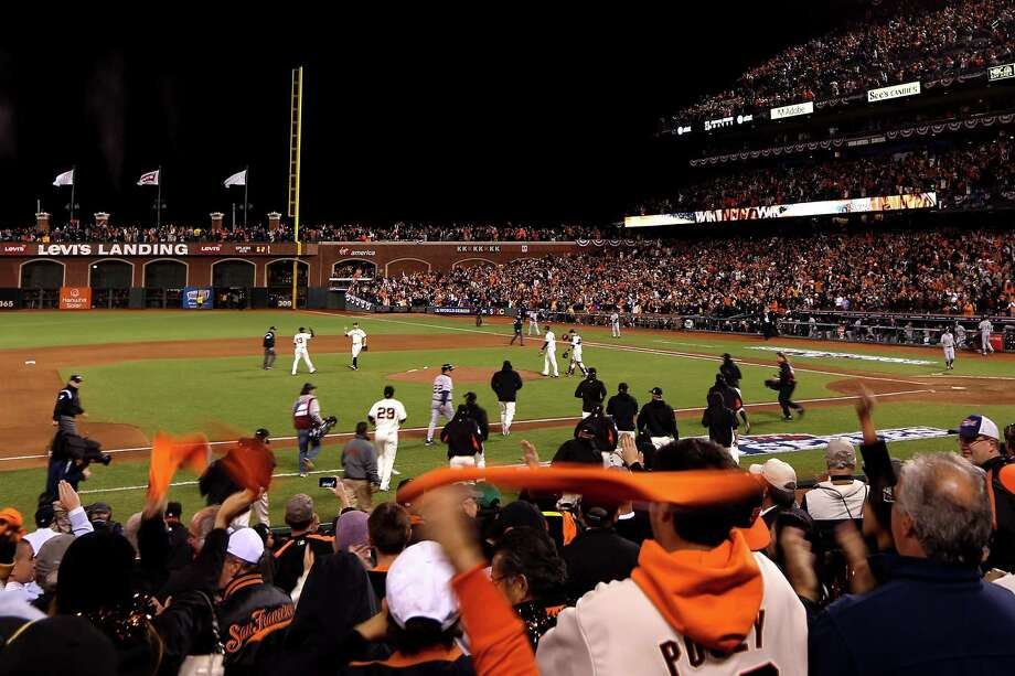 SAN FRANCISCO, CA - OCTOBER 24:  Fans cheer as The San Francisco Giants celebrate after defeating the Detroit Tigers in Game One of the Major League Baseball World Series at AT&T Park on October 24, 2012 in San Francisco, California. The Giants defeated the Tigers 8-3. Photo: Ezra Shaw, Getty Images / Getty Images North America