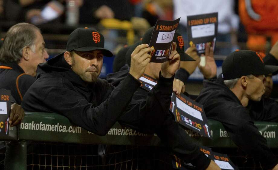 San Francisco Giants relief pitcher Jeremy Affeldt holds a Stand Up for Cancer sign for his father in Game 1 of the World Series against the Detroit Tigers at AT&T Park on Wednesday, October 24, 2012, in San Francisco, California. (Jose Luis Villegas/Sacramento Bee/MCT) Photo: Jose Luis Villegas, McClatchy-Tribune News Service / ARCHIVE