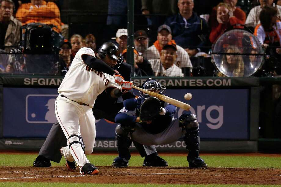 SAN FRANCISCO, CA - OCTOBER 24:  Pablo Sandoval #48 of the San Francisco Giants hits a single to center field against Al Alburquerque #62 of the Detroit Tigers in the seventh inning during Game One of the Major League Baseball World Series at AT&T Park on October 24, 2012 in San Francisco, California. Photo: Jason O. Watson, Getty Images / Getty Images North America
