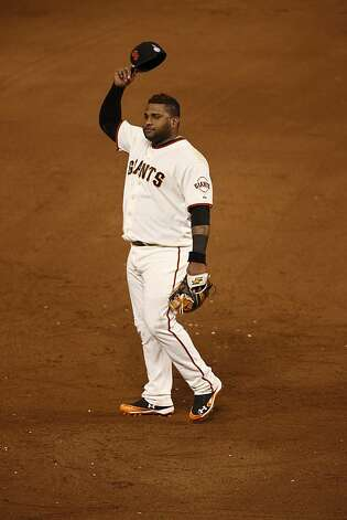Giants' 3rd baseman Pablo Sandoval removes his hat as prior to the start of the 5th inning during game 1 of the World Series at AT&T Park on Wednesday, Oct. 24, 2012 in San Francisco, Calif. Photo: Beck Diefenbach, Special To The Chronicle