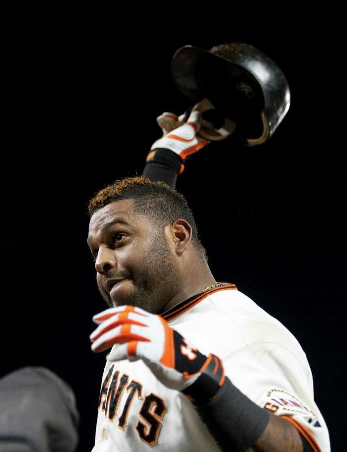 San Francisco Giants third baseman Pablo Sandoval tips his helmet to the crowd after hitting his third home run, a solo shot in the fifth inning, against the Detroit Tigers in Game 1 of the World Series at AT&T Park on Wednesday, October 24, 2012, in San Francisco, California. (Paul Kitagaki Jr./Sacramento Bee/MCT) Photo: Paul Kitagaki Jr., McClatchy-Tribune News Service / ARCHIVE
