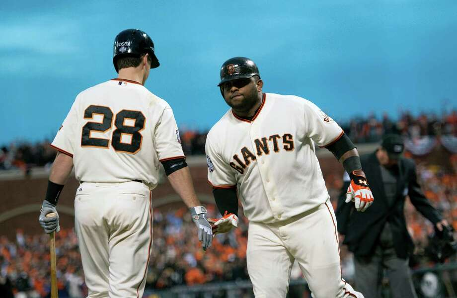 The San Francisco Giants' Pablo Sandoval is greeted by Buster Posey (28) after he hit his second home run, a two-run shot in the third inning, against the Detroit Tigers in Game 1 of the World Series at AT&T Park on Wednesday, October 24, 2012, in San Francisco, California. (Paul Kitagaki Jr./Sacramento Bee/MCT) Photo: Paul Kitagaki Jr., McClatchy-Tribune News Service / ARCHIVE