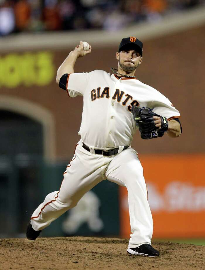 San Francisco Giants' George Kontos throws during the ninth inning of Game 1 of baseball's World Series against the Detroit Tigers Wednesday, Oct. 24, 2012, in San Francisco. (AP Photo/Marcio Jose Sanchez) Photo: Marcio Jose Sanchez, Associated Press / AP