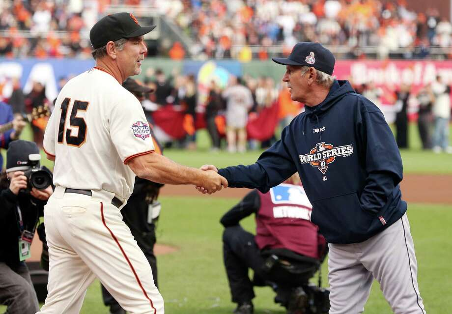 San Francisco Giants manager Bruce Bochy, left, shakes hands with Detroit Tigers manager Jim Leyland before Game 1 of baseball's World Series Wednesday, Oct. 24, 2012, in San Francisco. (AP Photo/Ezra Shaw, Pool) Photo: Ezra Shaw, Associated Press / Getty Images Pool